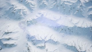 aerial view of snow covered terrain