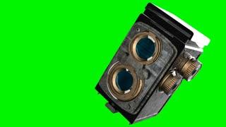 Vintage cinema camera on green chromakey
