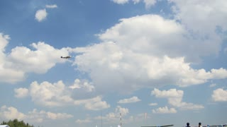 12 August 2016, Kazan, Russia - Kurkachi air show: the crowd at the festival looking at aerobatics planes, medium shot
