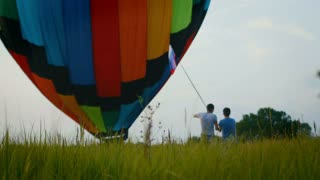 A balloon crew inflates the envelope of their hot air balloon