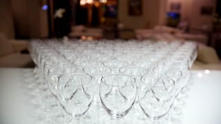 A lot of empty glasses on white table