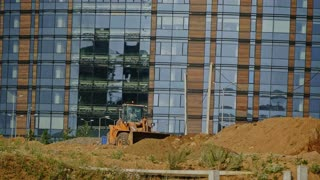 A new city is built: Grader machines working at construction site