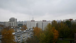 Aerial panorama of autumn city in cloudy sky