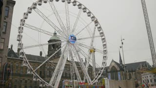AMSTERDAM, NETHERLANDS - 16 oct 2016, amusement Park - Ferris wheel on Dam Square - historical center of Holland CAPITAL, telephoto