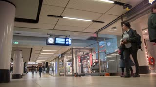 AMSTERDAM, NETHERLANDS - 18 OCTOBER, 2016: People inside of Amsterdam central railway station, time-lapse