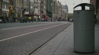 AMSTERDAM, NETHERLANDS -dustbin on street with the emblem of the city - triple x