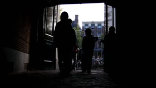 AMSTERDAM, NETHERLANDS - view of street - tourists, silhouette