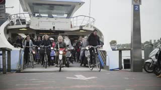 AMSTERDAM, THE NETHERLANDS. 18 oct 2016: Ferry to buiksloterweg passengers leave the vessel, slow-motion