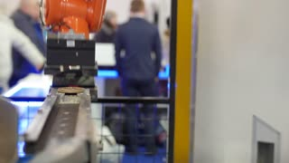 Automated robotic machine - mechanical arm for industrial welding on international exhibition