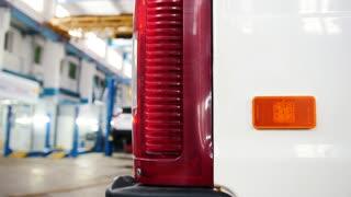 Automobile diagnostic service - mechanics working, manual labour