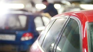 Automobile service - painting the car - defocused background