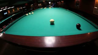 Billiards. A man hits a billiard ball