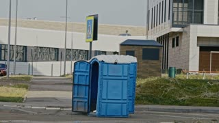 Blue public toilet at empty street of innopolis city