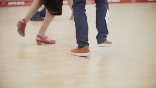 Boogie woogie dancing legs. Couples in ballroom on competitions