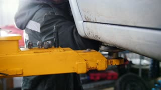 Car in auto service lifting for repairing, slider