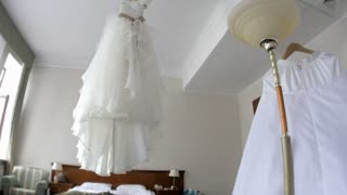Close up of a fashionable wedding dress on aceiling