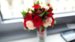 Colorful wedding flowers - bride's bouquet at window