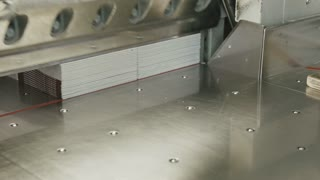 Cutting paper shears cutter guillotine machine in a printing factory, slider shot
