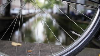Details of bicycle wheel at Amsterdam canal, Autumn, Netherlands