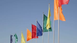 Different color flags fluttering in the wind, close up