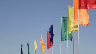 Different color flags fluttering in the wind.