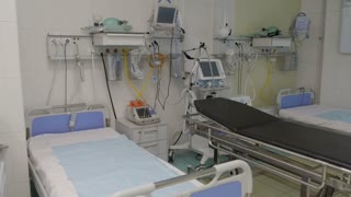 Empty Patient room with medical equipment in a modern hospital