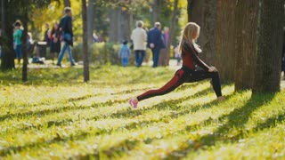 Fitness woman strength training doing workout at park. Fit caucasian sporty girl exercising her body at sunny autumn