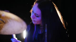 Girl percussion drummer performing with drums, slow motion