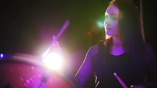 Gothic girl percussion drummer perform music break down - teen rock music , slow motion