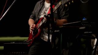 Guitar, drum. Rock Concert. Man playing musical instrument at concert