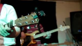 Guitar, drum. Rock Concert. Rock artists playing musical instrument at concert