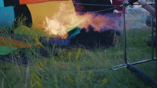 Hot air balloon burner firing and inflates the envelope