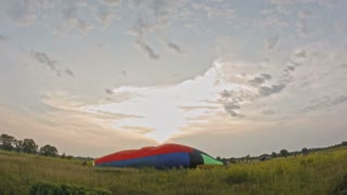 Hot Air Balloon Takes Flight at summer meadow