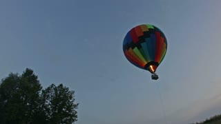 Hot air balloon takes off at dusk