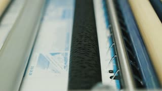 industrial printing of posters - print production, the developer in the photo process, close up