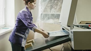 industrial printing process - worker monitors print quality