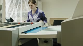 industrial printing process - worker monitors the printing process