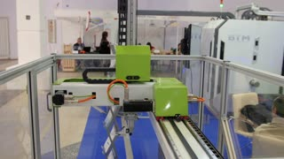 Industrial technology robotic machine for metal working on international exhibition