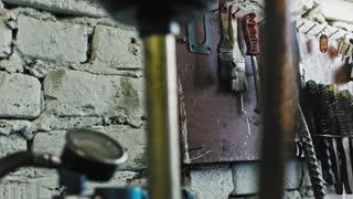 Iron metal tools for car repairing at vehicle service station, close up