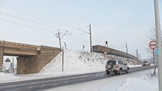 Kamaevo, Russia, 15 december 2016, winter road at snow-covered winter village at sunny day