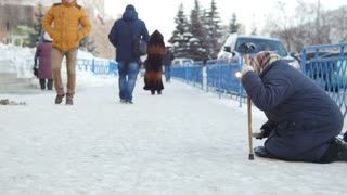 Kazan, Russia, 17 february 2017: Old woman beggars invalid asked money on street, poor disable people