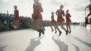 Kazan, Russia, 27 august 2016 - teens school girls cheerleaders dancing at triathlon competition, slow motion