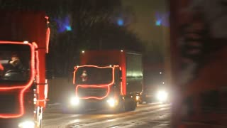 KAZAN, RUSSIA - DECEMBER 23, 2012: Festive Christmas caravan of Coca-Cola trucks driving on city streets
