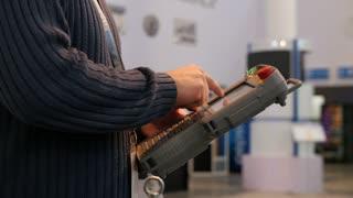 Man holding remote control for robotics arm technowelding on industry