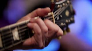 Man playing guitar at rock concert