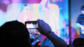 man with gadget at a rock concert