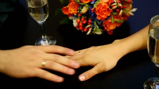 Man's and woman' hands on the table in cafe