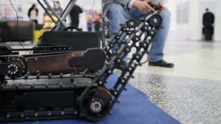 Military robot for discovery and searching on the remote control - moves by caterpillars