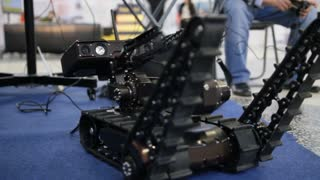 Military robot for discovery and searching on the remote control - moves the manipulators