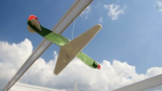 model aircraft on display hanging on against sky